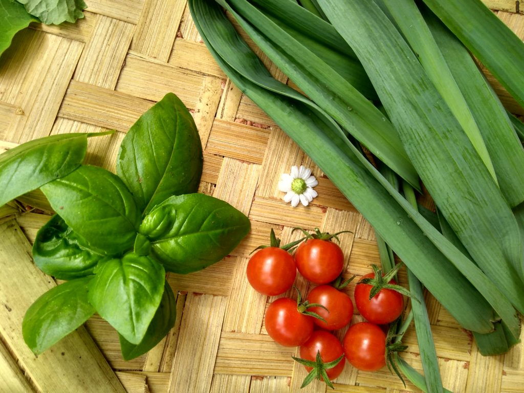Basil, Leeks, Cherry Tomatoes and a solitary Feverfew flower, all harvested from our veggie garden.